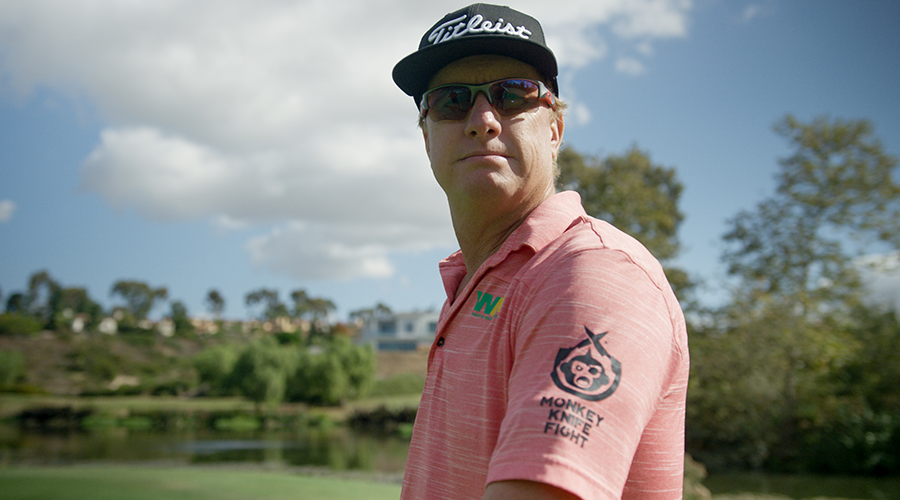 Charley Hoffman's golf shirt featuring the Monkey Knife Fight logo.